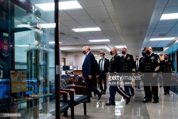 US President Donald Trump wears a mask as he visits Walter Reed National Military Medical Center in Bethesda Maryland' on July 11 2020