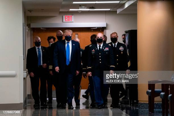 US President Donald Trump wears a mask as he visits Walter Reed National Military Medical Center in Bethesda Maryland on July 11 2020