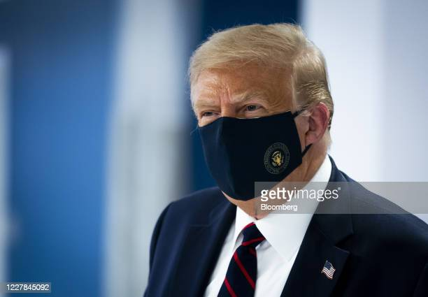 President Donald Trump wears a protective mask while visiting the American Red Cross National Headquarters in Washington, D.C., U.S., on Thursday,...