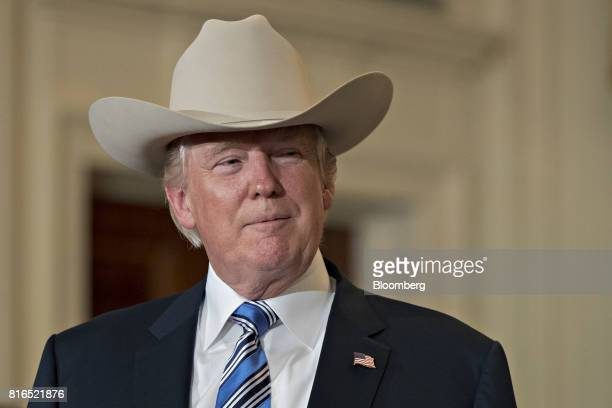 US President Donald Trump wears a Stetson cowboy hat while participating in a Made in America event with companies from 50 states featuring their...