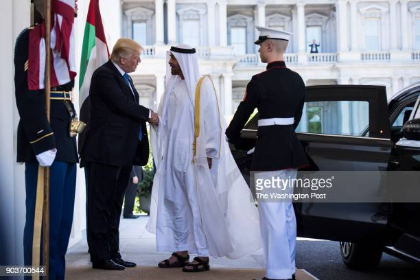 President Donald Trump welcomes Abu Dhabi's Crown Prince Sheikh Mohammed bin Zayed Al Nahyan outside the West Wing of the White House in Washington...