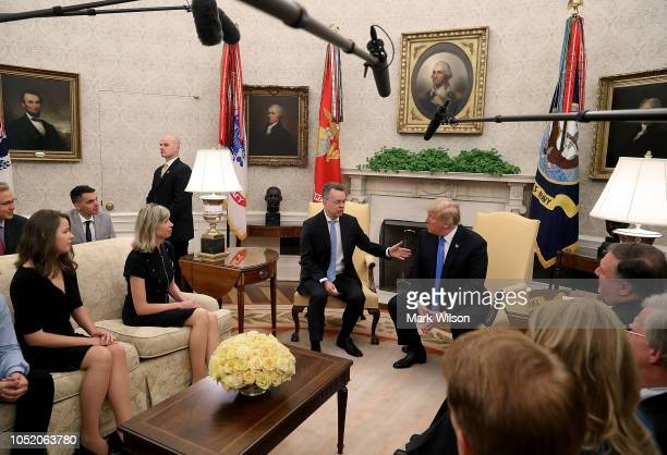 S President Donald Trump welcomes American evangelical Christian preacher Andrew Brunson in the Oval Office a day after he was released from a...