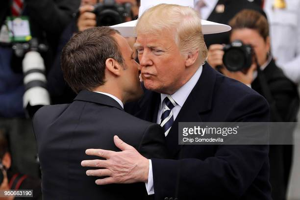 S President Donald Trump welcomes French President Emmanuel Macron to the White House during a state arrival ceremony April 24 2018 in Washington DC...