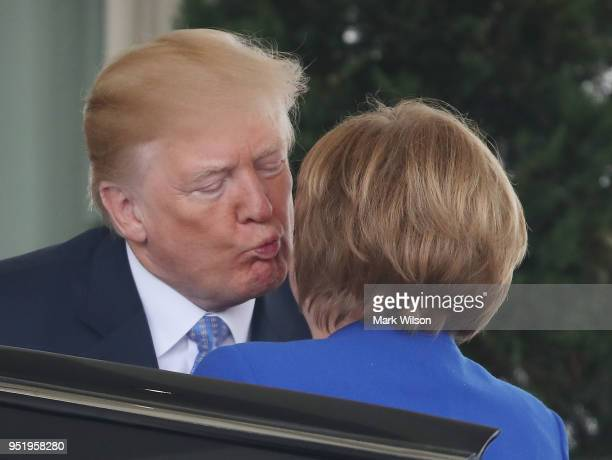 S President Donald Trump welcomes German Chancellor Angela Merkel at the West Wing of the White House on April 27 2018 in Washington DC President...