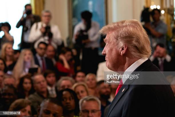US President Donald Trump welcomes guests at an event where he signed an executive order establishing a National Council for the American Worker...