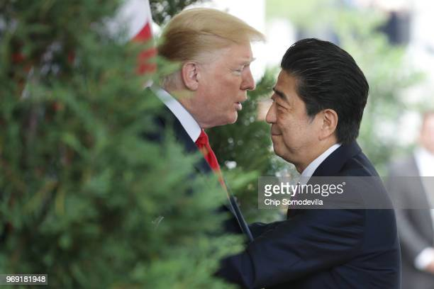 S President Donald Trump welcomes Japanese Prime Minister Shinzo Abe to the White House June 7 2018 in Washington DC Trump and Abe are expected to...