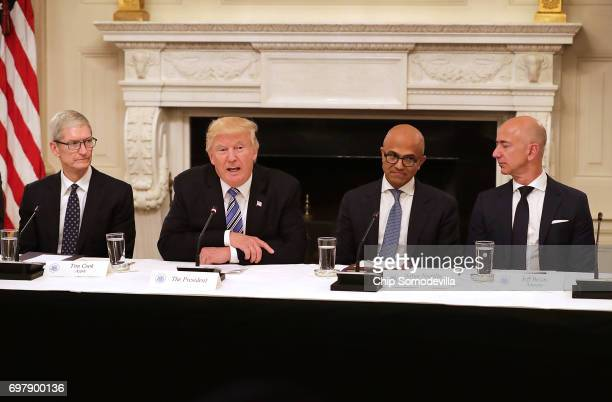 S President Donald Trump welcomes members of his American Technology Council including Apple CEO Tim Cook Microsoft CEO Satya Nadella and Amazon CEO...