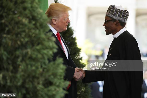 S President Donald Trump welcomes Nigerian President Muhammadu Buhari to the White House April 30 2018 in Washington DC The two leaders are scheduled...