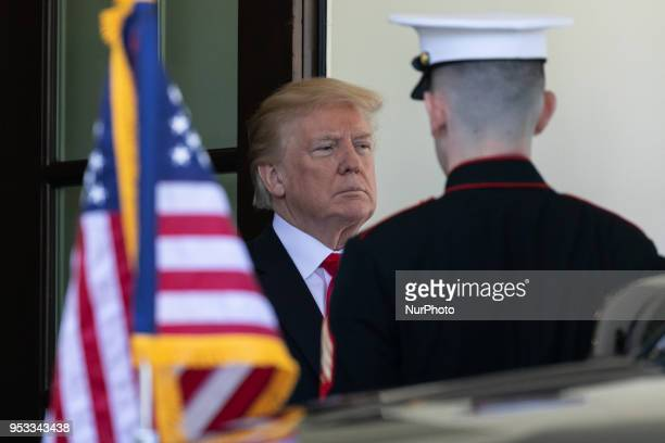 US President Donald Trump welcomes President Muhammadu Buhari of the Federal Republic of Nigeria to the West Wing Portico of the White House in...