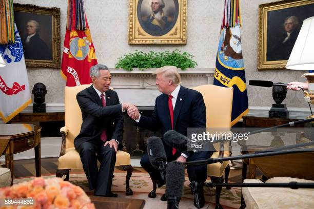 US President Donald Trump welcomes Prime Minister Lee Hsien Loong of Singapore to the Oval Office before a series of meetings between the two at the...
