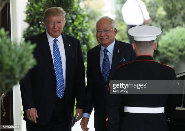 S President Donald Trump welcomes Prime Minister Najib Abdul Razak of Malaysia outside the West Wing of the White House September 12 2017 in...