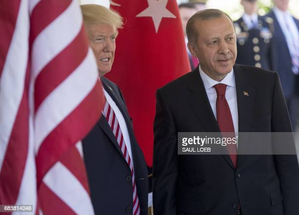 US President Donald Trump welcomes Turkish President Recep Tayyip Erdogan as he arrives for meetings at the White House in Washington DC May 16 2017...