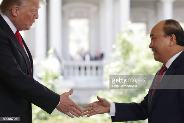 S President Donald Trump welcomes Vietnamese Prime Minister Nguyen Xuan Phuc to the White House May 31 2017 in Washington DC According to Phuc the US...
