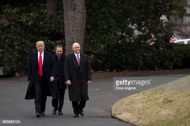 President Donald Trump White House Chief of Staff Reince Priebus and Vice President Mike Pence walk on their way to greet Harley Davidson executives...
