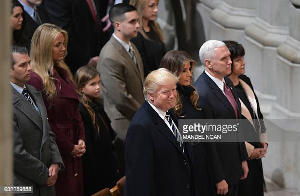 US President Donald Trump wife Melania Vice President Mike Pence and wife Karen attend the National Prayer Service at the National Cathedral on...