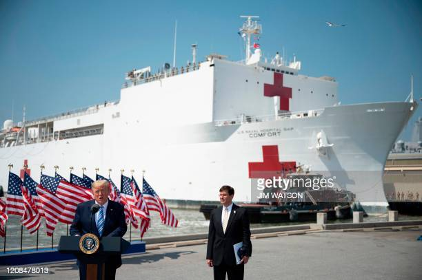 US President Donald Trump with Defense Secretary Mark Esper speaks during the departure ceremony for the hospital ship USNS Comfort at Naval Base...