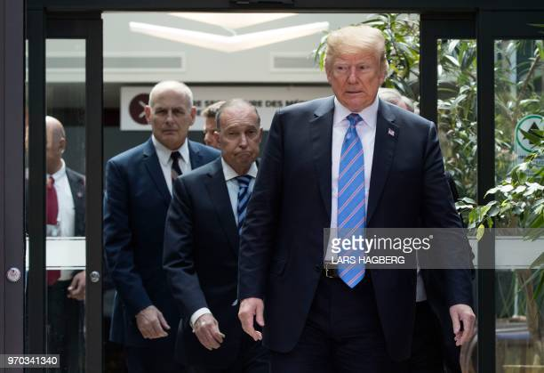 President Donald Trump with Director of the National Economic Council National Larry Kudlow and White House Chief of Staff John Kelly leaves the G7...