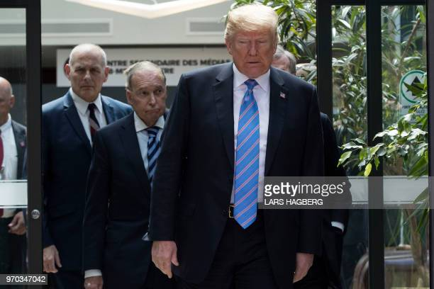 US President Donald Trump with Director of the National Economic Council National Larry Kudlow and White House Chief of Staff John Kelly leaves the...