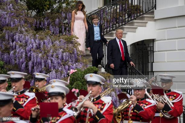 President Donald Trump with first lady Melania Trump and their son Barron Trump walk down from the Truman Balcony after speaking during the 139th...