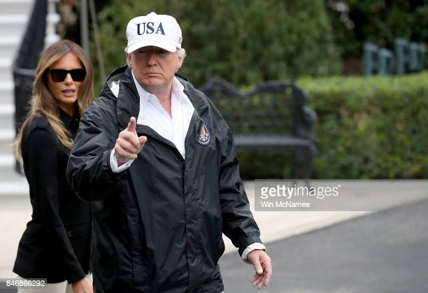 S President Donald Trump with first lady Melania Trump gestures as he answers questions while departing the White House September 14 2017 in...