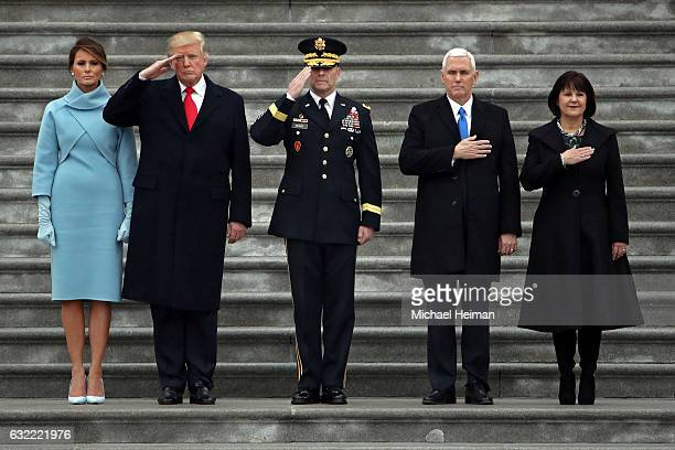 S President Donald Trump with first lady Melania Trump Maj Gen Bradley Becker Vice President Mike Pence and his wife Karen Pence review troops on the...