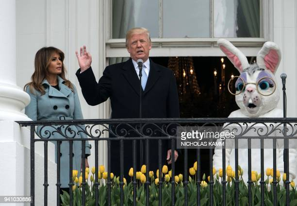 US President Donald Trump with First Lady Melania Trump speaks during the annual Easter Egg Roll at the White House in Washington DC on April 2 2018...
