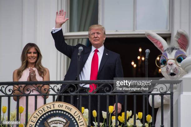 President Donald Trump with first lady Melania Trump speaks from the Truman Balcony during the 139th Easter Egg Roll on the South Lawn of the White...