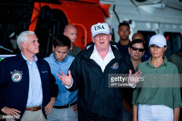 US President Donald Trump with First Lady Melania Trump US Vice President Mike Pence US Senator Marco Rubio speaks during a briefing on Hurricane...