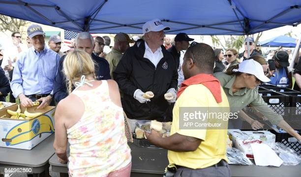 US President Donald Trump with Florida Governor Rick Scott US Vice President Mike Pence and First Lady Melania Trump helps serve food to people...