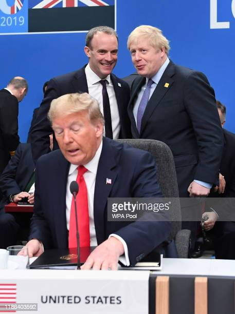 President Donald Trump with Foreign Secretary Dominic Raab and British Prime Minister Boris Johnson onstage during the annual Nato heads of...