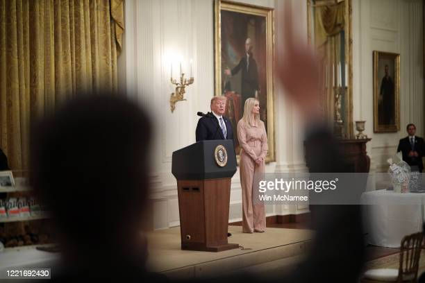S President Donald Trump with his daughter Ivanka takes questions from reporters during an event on supporting small businesses through the Paycheck...