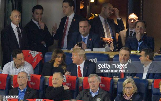 President Donald Trump with his wife Melania during a game between the Washington Nationals and the Houston Astros in game 5 of the World Series at...