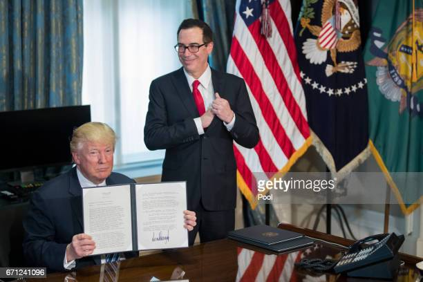 US President Donald Trump with Secretary of Treasury Steven Mnuchin participate in a financial services Executive Order signing ceremony in the US...