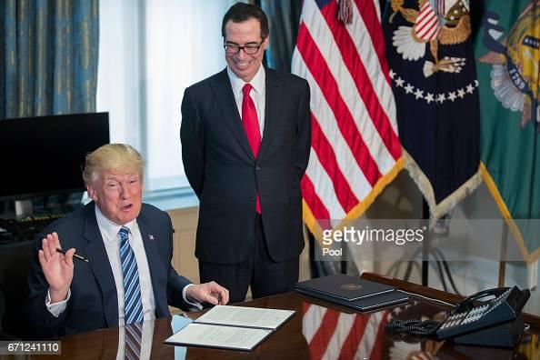 U.S. President Donald Trump , with Secretary of Treasury ...