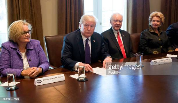 US President Donald Trump with Sen Claire McCaskill Sen Orrin Hatch Chairman of the Senate Finance Committee and Sen Debbie Stabenow speaks during a...