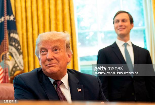 US President Donald Trump with Senior Advisor to the President Jared Kushner listens in the Oval Office of the White House in Washington DC on...