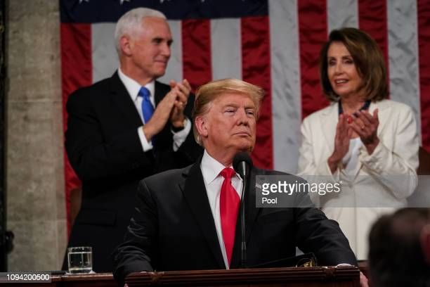 S President Donald Trump with Speaker Nancy Pelosi and Vice President Mike Pence looking on delivers the State of the Union address in the chamber of...