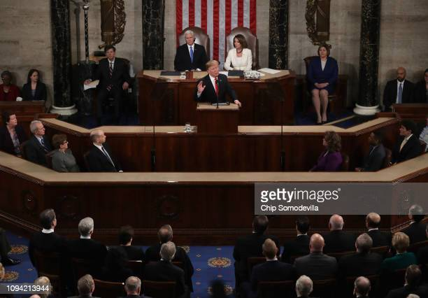 President Donald Trump with Speaker Nancy Pelosi and Vice President Mike Pence looking on delivers the State of the Union address in the chamber of...
