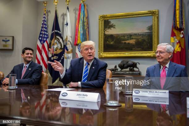 President Donald Trump with Speaker of the House Paul Ryan and Senate Majority Leader Mitch McConnell delivers remarks during a meeting with members...