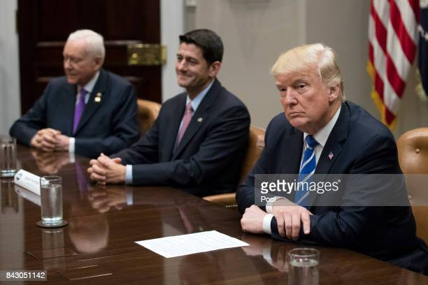 President Donald Trump with Speaker of the House Paul Ryan Chairman of the Senate Finance Committee Orrin Hatch and other members of congress and his...
