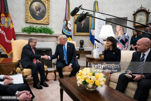 President Donald Trump with US Ambassador to the United Nations Nikki Haley and National Security Adviser HR McMaster by his side shakes hands with...
