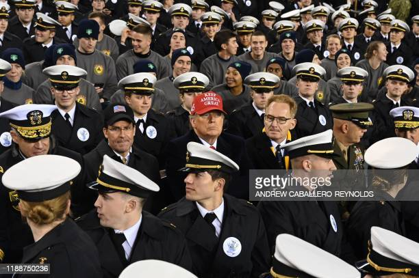 US President Donald Trump with US Defense Secretary Mark Esper and Acting United States Secretary Thomas Modly joins Naval Academy cadets during the...