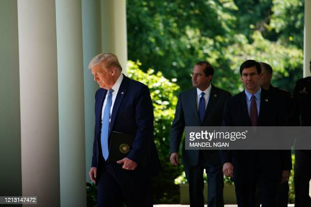 President Donald Trump, with US Defense Secretary Mark Esper and US Secretary of Health and Human Services Alex Azar , arrives to speak on vaccine...