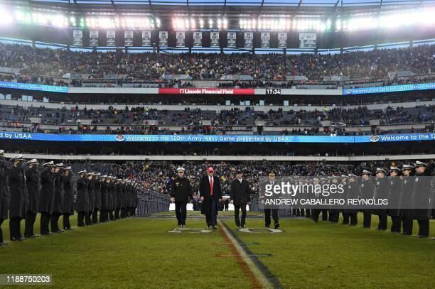 US President Donald Trump with US Defense Secretary Mark Esper attends the Army v Navy American Football game in Philadelphia on December 14 2019