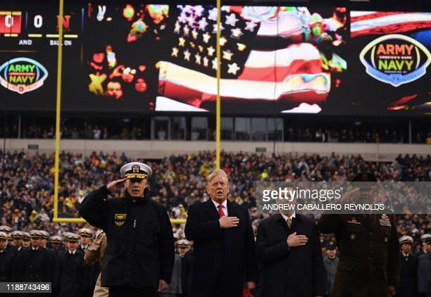US President Donald Trump with US Defense Secretary Mark Esper sings the National Anthem before the Army v Navy American Football game in...