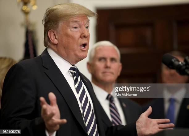 S President Donald Trump with US Vice President Mike Pence speaks about the cancelled summit with North Korean leader Kim Jongun during a bill...