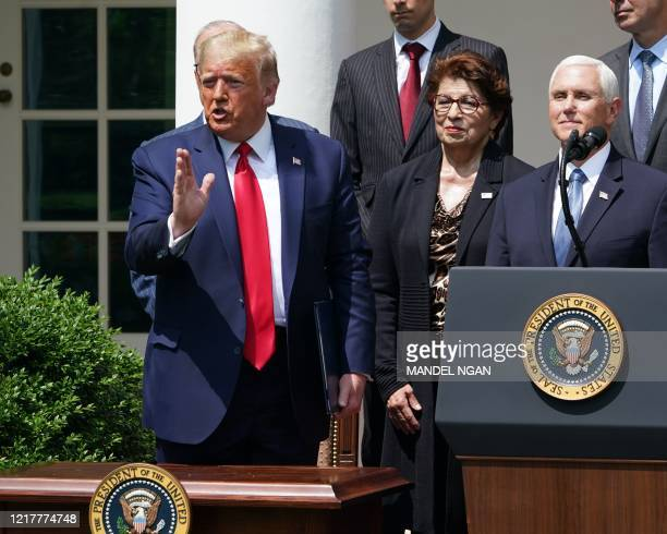 US President Donald Trump with US Vice President Mike Pence speaks after signing the Paycheck Protection Program Flexibility Act of 2020 during a...