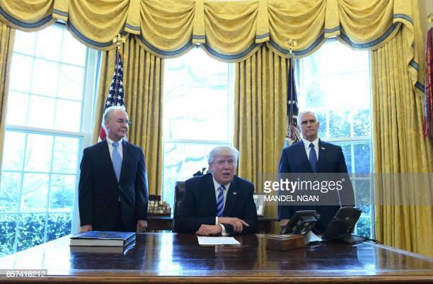 US President Donald Trump with Vice President Mike Pence and Health and Human Services Secretary Tom Price speaks from the Oval Office of the White...