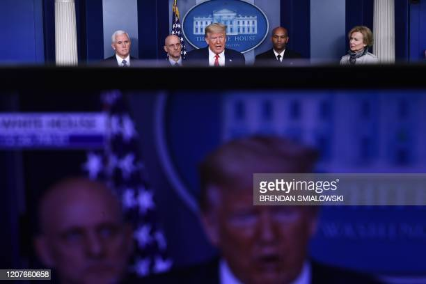 US President Donald Trump with Vice President Mike Pence FDA Commissioner Stephen Hahn US Surgeon General Dr Jerome Adams and White House Coronavirus...
