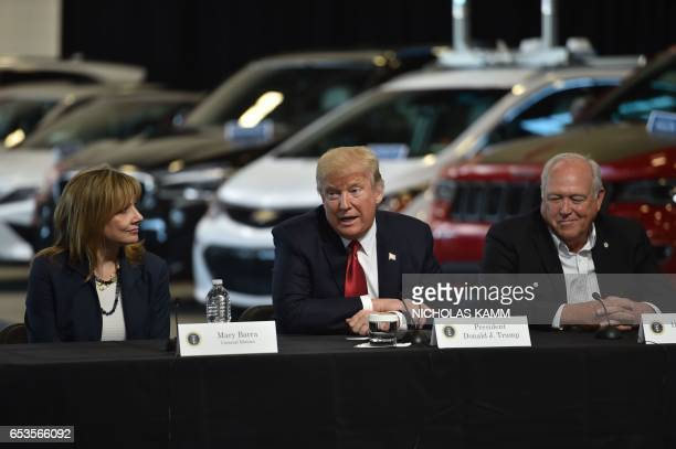 US President Donald Trumpdelivers remarks at American Center for Mobility in Ypsilanti Michigan with General Motors CEO Mary Barra and Dennis...